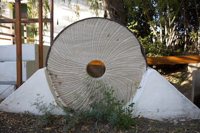 A millstone outside the Alberts Mill, Prince Albert